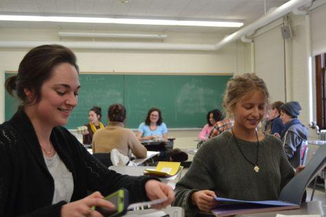 Emilee Herrick and Emily Goonan preparing research in class