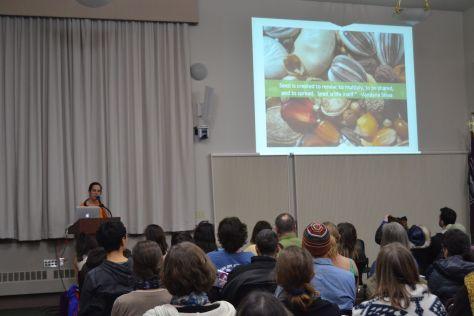 Oona Coy presenting a talk on seed saving